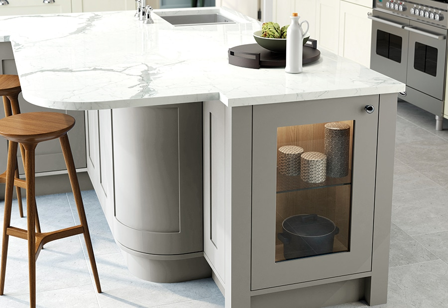 Burleigh painted porcelain stone kitchen with curved island - Riley James Kitchens Gloucestershire