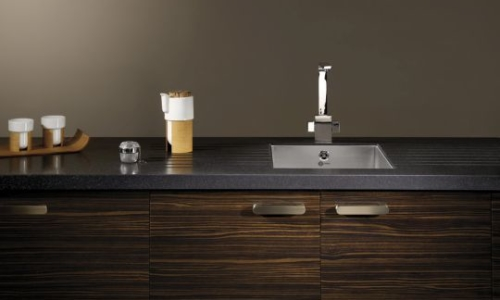 Bushboard's Encore solid surface in Black Sparkle cover, available from Riley James Kitchens Gloucestershire