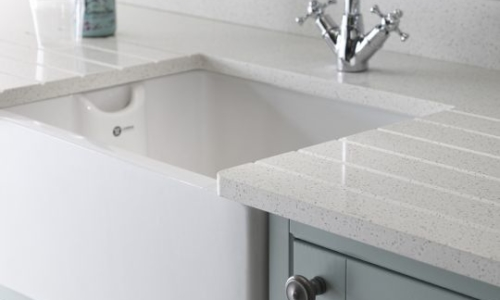 Bushboard's M-stone White 03 LS LR, available at Riley James Kitchens Gloucestershire