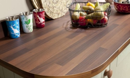 Bushboards-Omega-Antique-Block-Walnut-laminate-worksurface-with-rounded-end, from Riley James Kitchens Stroud